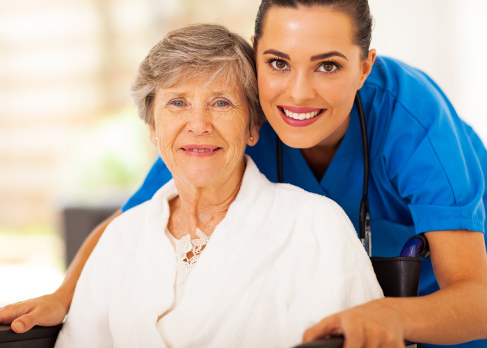 caregiver and older woman smiling